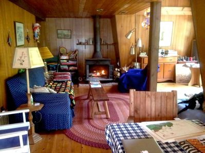 Longer shot of the living room, with woodstove for chilly nights