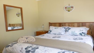 The comfortable queen bedroom in Banksia Cottage at Eagles Rise, Sisters Beach
