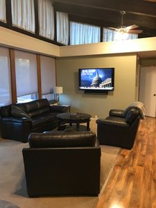 "Living room with new leather couch set & 60"" SmartTV + AppleTV!"
