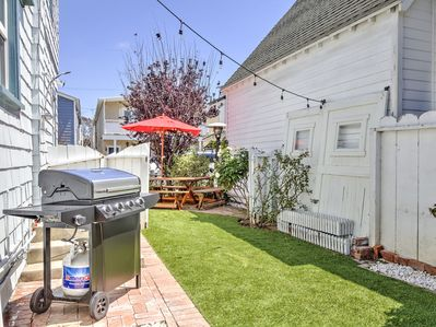 Backyard - The private backyard features a grill and decorative string lights.