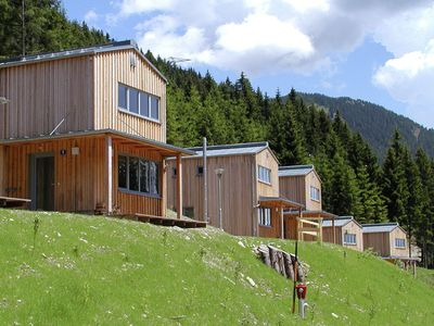 Photo for Sunny woodland chalet near chairlift.