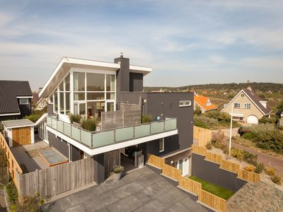 Photo for Villa By the Sea, a modern beach villa with indoor swimming pool in Bergen aan Zee