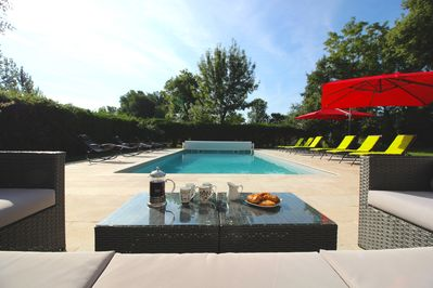 Relax in style by the heated pool