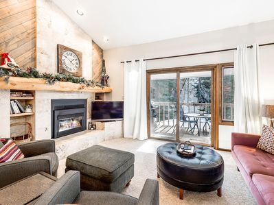 Living Room - A comfortable living area features vaulted ceilings, rustic timber accents, and vintage ski decor.