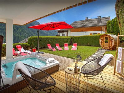 Photo for 5* Ski chalet in heart of village, sauna, hot tub, terrace - OVO Network