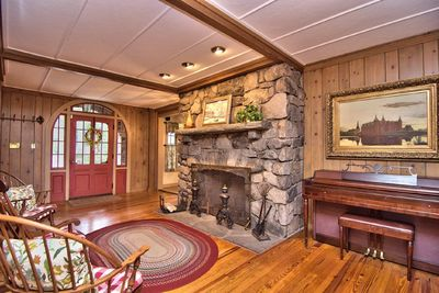 Foyer with fireplace and piano