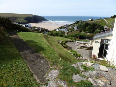 Photo for Ground floor apartment in Mawgan Porth with sea views, sleeps 4, dog friendly.