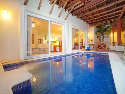 Photo for Steps from the beach with private heated pool and incredible views