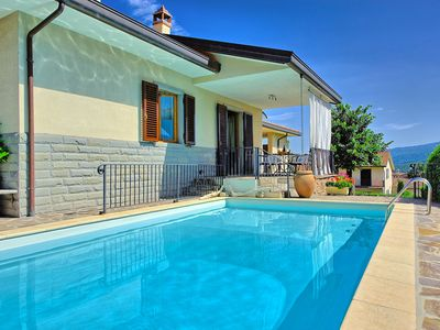Photo for Pretty villa with private pool and gardens located within a traditional village