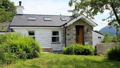 Nestled in the mountains this cottage has a private garden and woodland.