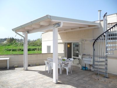 Large terrace directly off kitchen has cover and lighting for all weathers