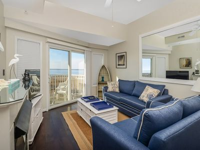 Photo for Cute, but classy 2-bedroom condo with beautiful sunset view with rooftop outdoor pool and free internet located midtown on the bay water!