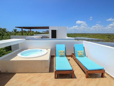 Photo for Luxury Home with Rooftop steps away from Beach by Olahola