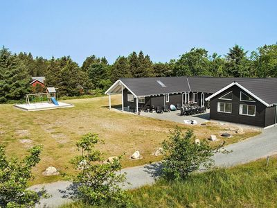 Photo for Spacious Holiday Home in Blavand with Swimming Pool