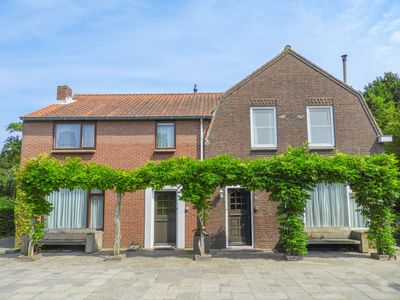 Photo for Beautiful 16-person holiday home in Vrouwenpolder, 200 meters from the beach
