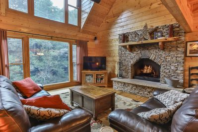 Leather sofas, real stacked stone fireplace with incredible views of the river