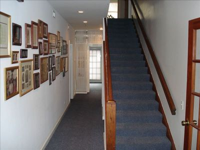 Hallway from the front door.  Take a look at the picture wall!