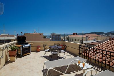 Our Rooftop terrace with Gas barbecue, Sun beds, Umbrellas & dining area