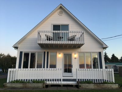 Photo for Water view cottage, steps from Semi private beach overlooking Shediac Bay