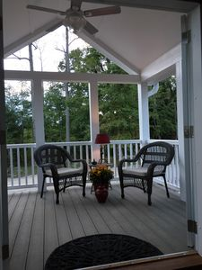 French Doors open from the living room to the open air front porch.   Relax!!!