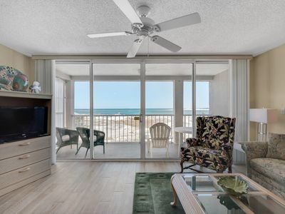 Photo for Bright, bay view condo, Steps to the beach, Beach service and bicycles included