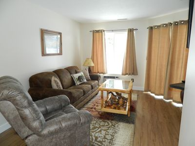 Updated Cozy living area with pull out queen sofa