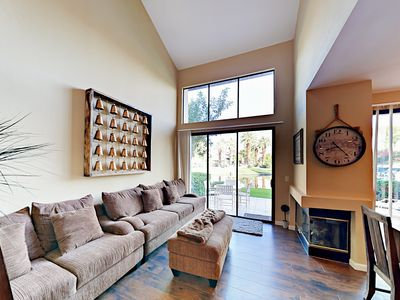 Family Room - Stretch out next to the fireplace on a sofa and matching love seat in the family room.