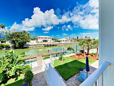 Photo for Canal-Front 4BR w/ Private Pool, Dock, Kayaks & SUP - Walk to Sombrero Beach