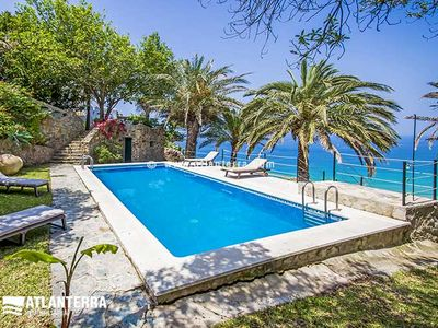 Photo for Charming villa with incredible views of the Atlanterra beach. SWIMMING POOL