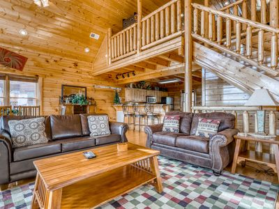 Photo for Stunning log cabin w/ a pool table, foosball, & long-range mountain views