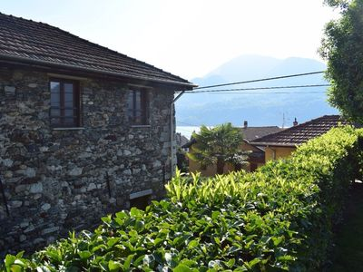Photo for THE AMAZING COTTAGE - Private SWIMMING POOL and private BEACH on lake Orta