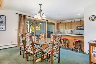 Dining room with seating for 6, breakfast bar with seating for 3 and deck access to the golf course.
