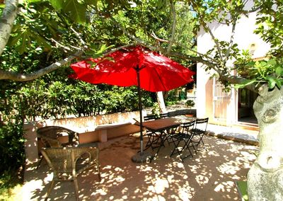 In the shade of the terrace of The Fig Frees Villa