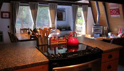 Remodeled kitchen with ceramic cooktop stove.