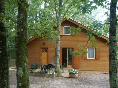 Photo for Quietly located chalet with private pool by the edge of the historical forest.