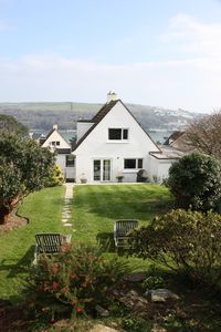 Back garden and view of the house from the upper rockery