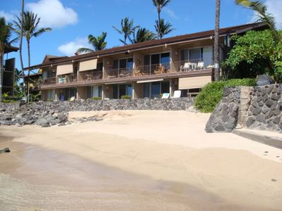 Photo for Luxury Condo 20 feet from the ocean! Sleeps 4!  Private beach with turtles!