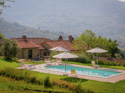 Photo for Villa with private swimming pool and stunning views across hilly surroundings