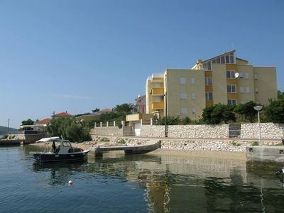 Photo for Holiday apartment with air conditioning, seafront