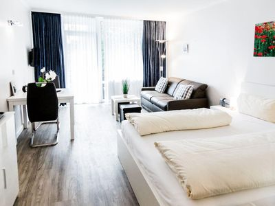 Photo for Cozy room for 3 persons with balcony and lake view!