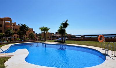 Photo for Stunning sea, golf and mountain views ground floor apartment in Coto Real!