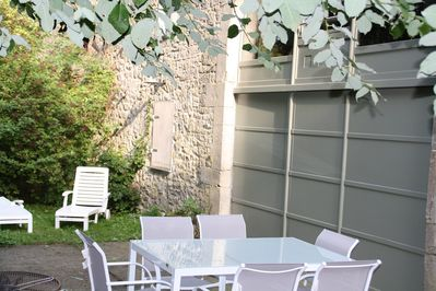 The private terrace with garden  furnitures and barbecue