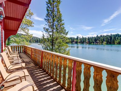 Photo for Cozy lakefront log cabin w/ lake views, a wood stove, vintage decor, & dock.