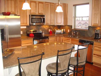 Full Kitchen With Large Counter & Chairs