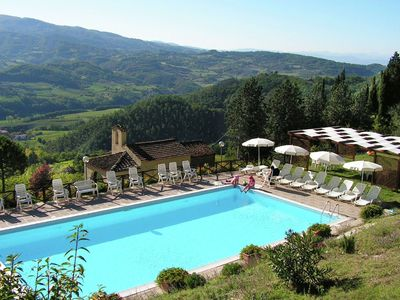 Photo for Attractive apartment in vineyard with swimming pool and views over Tuscany
