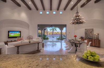 Panoramic view from kitchen. Living on left, dining on right, patio in middle