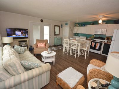 Photo for Cute, fun 3-bedroom condo with adorable beach decor and free WiFi located midtown and just a block to the beach!