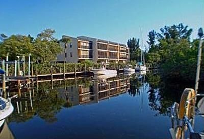 Photo for Perfect Seasonal Rental.Canal Front Condo.Less than mile to beach.40ft boat slip