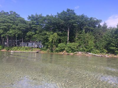View of house and part of Detroit Point from water.