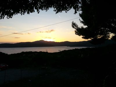Photo for Island of Elba, two-room apartment with terrace overlooking the sea at sunset